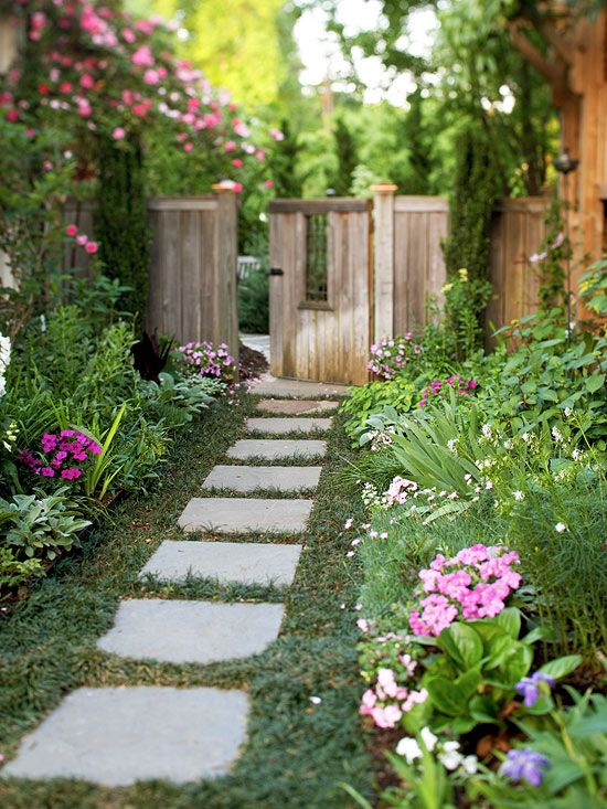 If your space is small, create windows, as seen in this gate, and vary the height of your plants or structures. That will give the area some visual relief -- and give your yard a playful quality.