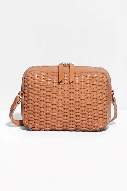 A braided pattern is the perfect, picnic-esque twist on a classic neutral shade and easily wearable shape. & Other Stories Braided Shoulder Bag, $125, available at & Other Stories.  #refinery29 http://www.refinery29.com/crossbody-purses#slide-8