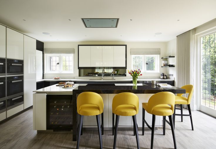 Whilst a monochrome colour scheme lends itself well to contemporary design, adding a pop of colour through accessories of fabric can be a great way to add interest a create a unique space   Kitchen: Neil Lerner Kitchen Designs