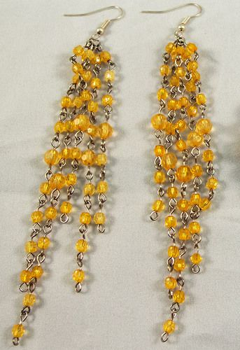 These are beautiful silver earrings with yellow transparent beads. The earrings measure at 12 cm.