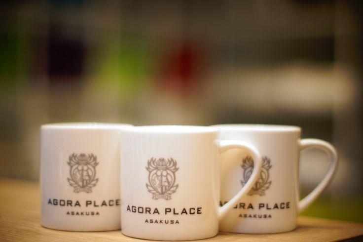AGORA Place coffee mugs.