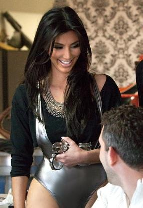 Who made Kim Kardashian's silver bathing suit and black shirt that she wore for a photoshoot on her new calendar?