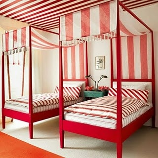 Twin beds with canopies and stripes