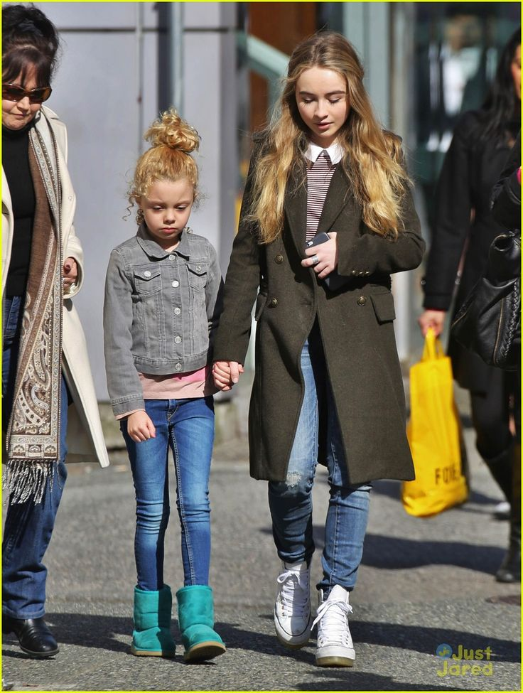 Sabrina Carpenter holds onto Mallory James Mahoney's hand as they head to the set of Further Adventures in Babysitting in Vancouver, Canada