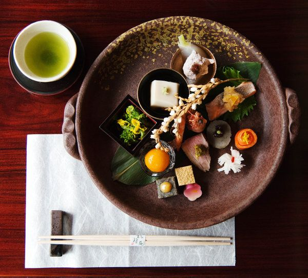A dish in Kyoto, Japan.  Everything in it looks tiny and interesting.