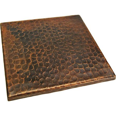 add this lovely hammered copper tile to your backsplash to evoke the