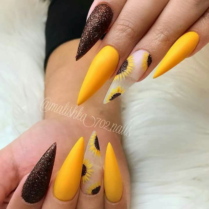 Sunflower and black designed nails