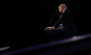 Debate fact-check: Hillary Clinton and Donald Trump's claims reviewed caption:Donald Trump on stage during the final debate.