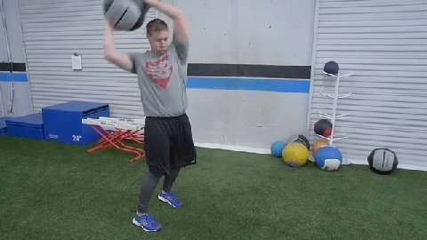 Miami pitcher Tom Koehler performs a five-exercise series during an off-season workout to develop the explosive power and core stability he needs for hard and accurate pitches.