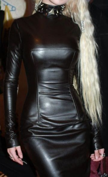 17da9116caa79 Blonde in sexy long sleeve leather dress and spiked choker collar ...