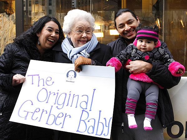 Original Gerber Baby model Ann Turner Cook (center), with Sara and Billy Montoya, parents of new model Mary Jane Montoya. (Amy Sussman/ /AP Images for Gerber)