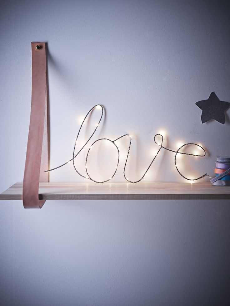 Bring a little love to any room with this delicate silver wire light. The elegant looped letters are strung with warm white LED bulbs, and can be hung on your wall or propped as part of a display.