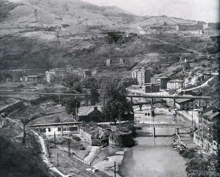 Bilbao, island of St. Cristóbal and the three bridges in La Peña district.
