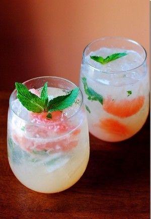 pink grapefruit mojito mimosa. Loving the soft peaches and stronger orange set alight with that fresh verdant green.
