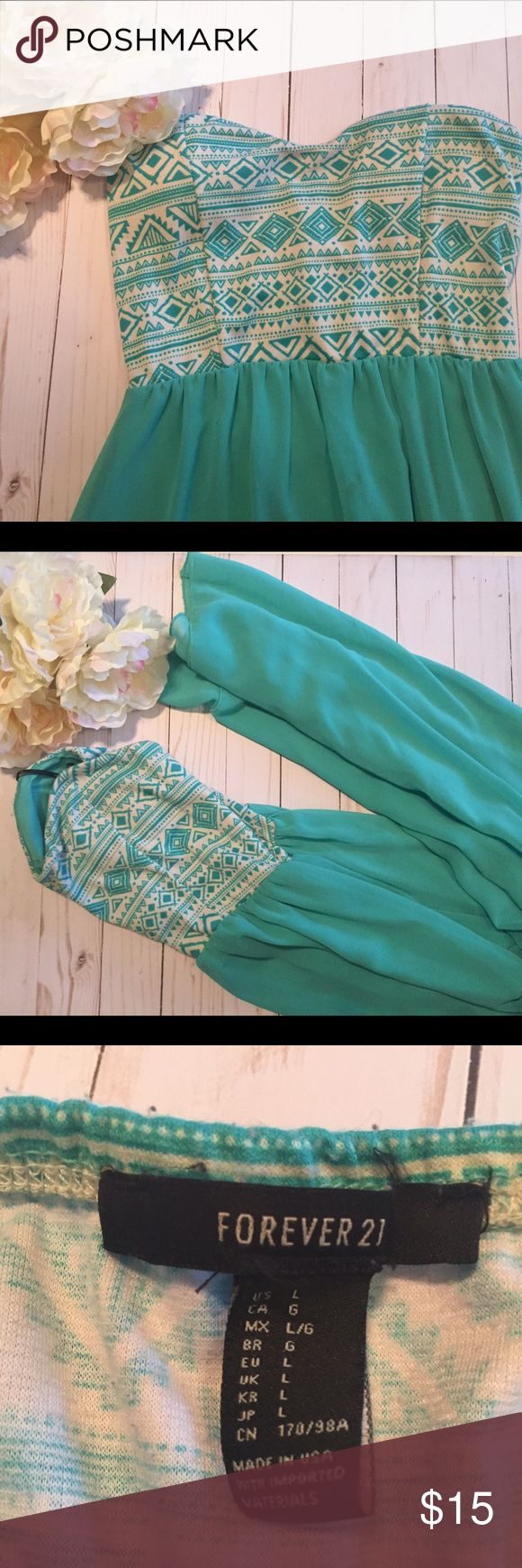 Aztec Maxi Dress Aqua/Teal Aztec patterned top Maxi Dress with a sheer flowy skirt. Short slit but otherwise see through flirty skirt. Very flattering sweetheart neckline with a fitted but stretchy bodice. Forever 21 Dresses Maxi