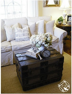 Gorgeous room - love the white slipcovers against the dark steamer trunk coffee table. By Ethereal Plus
