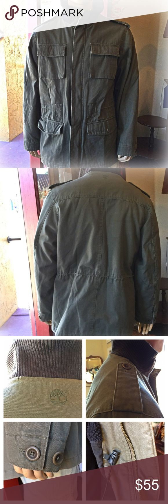 Timberland Rugged Military Jacket Men's Men's Timberland coat. 4 front pockets 2 with snaps, 2 with buttons. 1 inside pocket. Drawcord at waist. Zipper and snap closure. Only sign of wear is by the back of the neck -see 1st picture in 1st collage. This is an awesome jacket!! Timberland Jackets & Coats Military & Field
