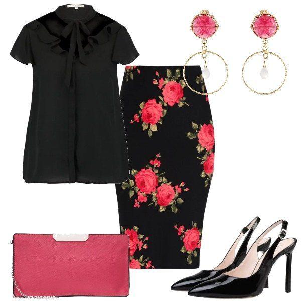 Outfit composto da gonna a tubino a fantasia floreale, camicetta monocromo con fiocco al collo e scarpe Chanel nere. Completano il look gli orecchini con dettagli in cristallo e la pochette in similpelle.