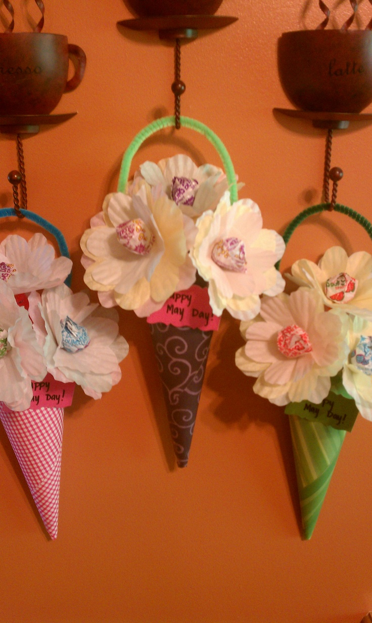 May Day Baskets ... dum dum suckers, paper cupcake cups, paper, & pipe cleaners!!