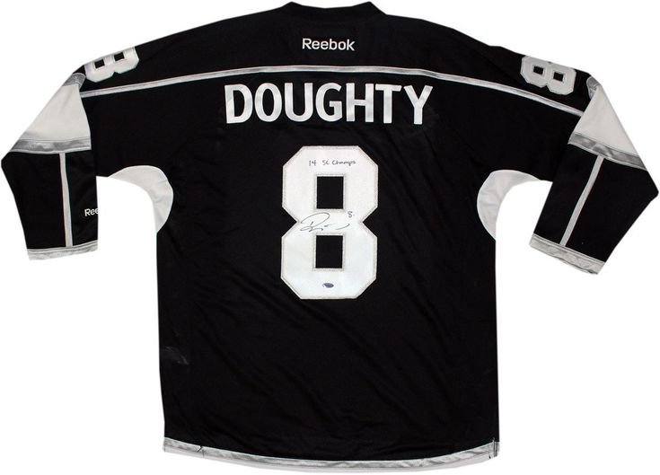 Kings' Star Drew Doughty has personally hand-signed this Black Los Angeles Kings Jersey With Stanley Cup Patch and inscribed it 14 SC Champs $749.99