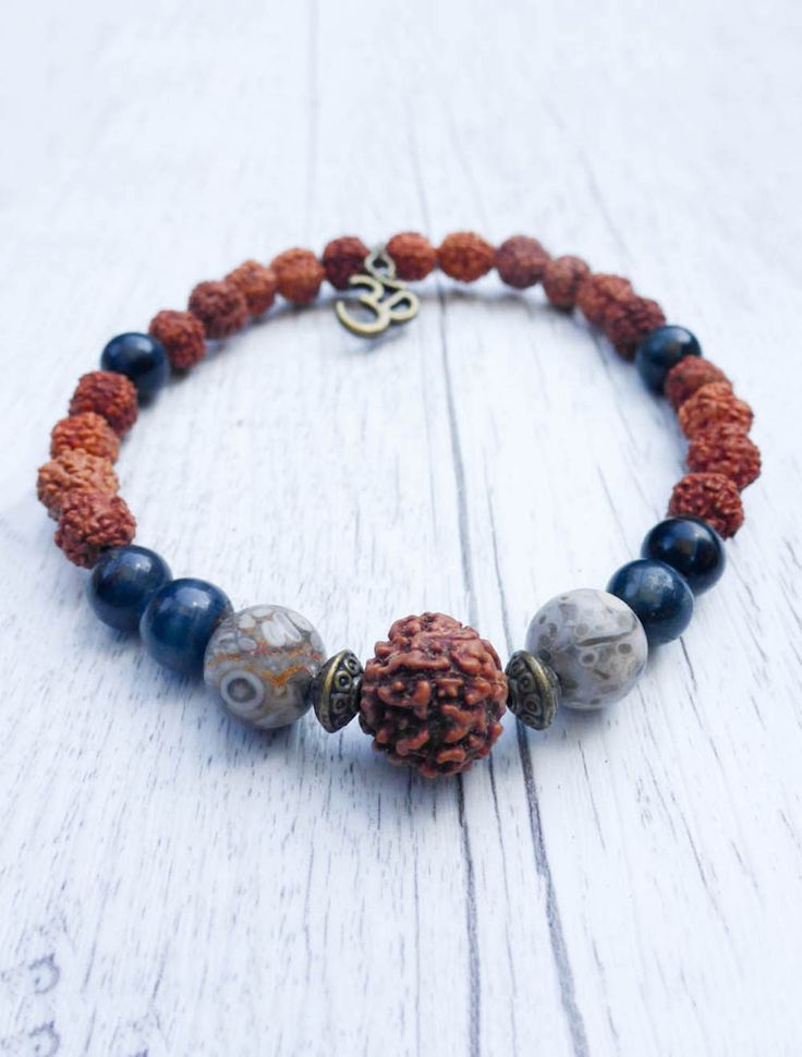 Pin now, shop later! The What Goes Around Mala Bracelet  Rudraksha, Blue Tigers Eye and Ocean Fossil  What goes around resonates with karmic energy. It increases ones spiritual wisdom and stimulates taking action.  Mala Kamala Mala Beads - Boho Malas, Mala Beads, Yoga Jewelry, Meditation Jewelry, Mala Necklaces and Bracelets, Mala Headpieces, Childrens Malas, Bohemian Jewelry and Baby Necklaces