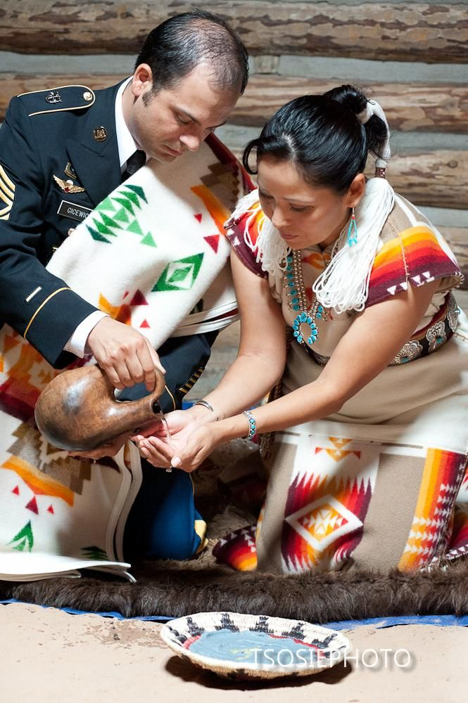 Navajo wedding... really cool that he wore his service dress uniform AND (what I'm assuming) is a traditional Navajo blanket.