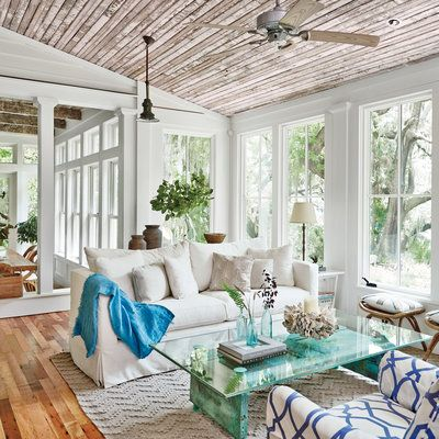 Casement windows in this living room highlight the romantic Southern character of the Lowcountry landscape outside.