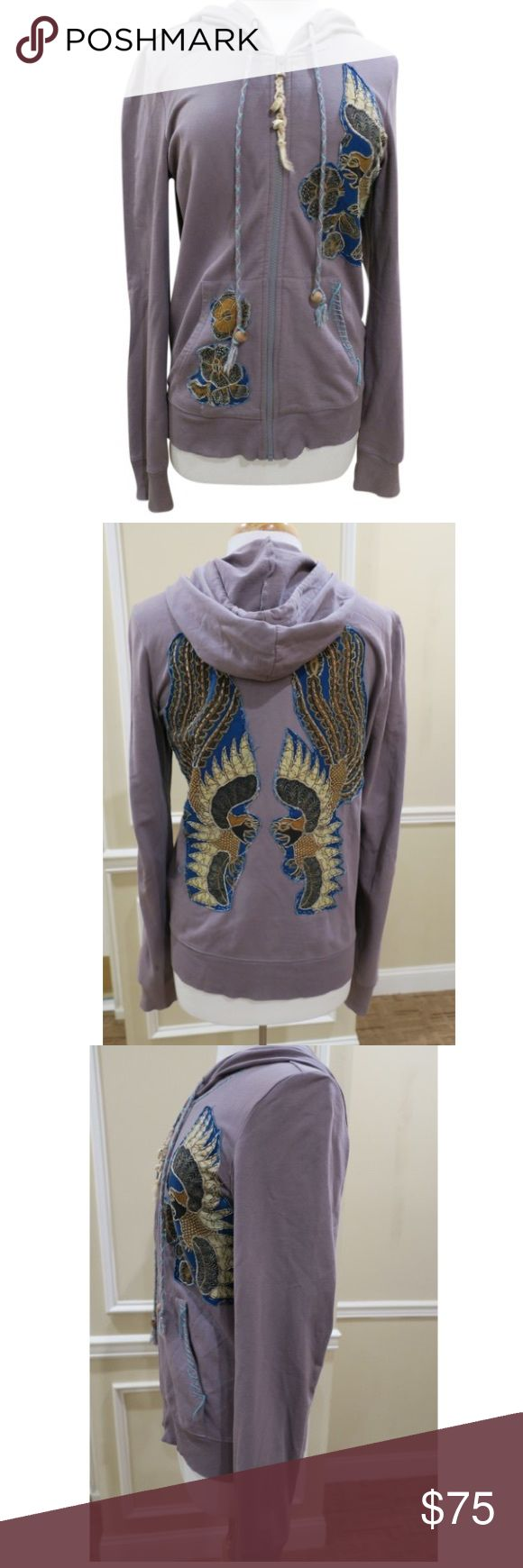 Free People Beaded Embellished Eagle Sweatshirt Beautiful embellished hoodie with eagle and flower designs. Very comfortable, but the beading and patches give it a much more vibrant look than your average sweatshirt. It looks great over a t-shirt and jeans but also cute over dresses. The color is grey, leaning towards the purple family. Boho look. The shape is great, somewhat form fitting, not too boxy. The zipper pull has shell details as pictured. Size medium. 100% cotton. Free People Tops…