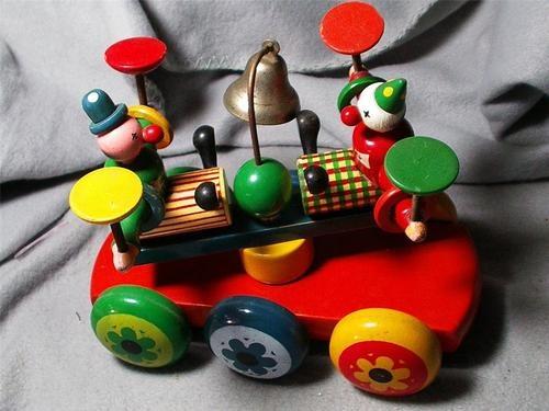 Kouvalias Wooden Toys ~ Kouvalias s rotating clowns pie plates wooden pull toy