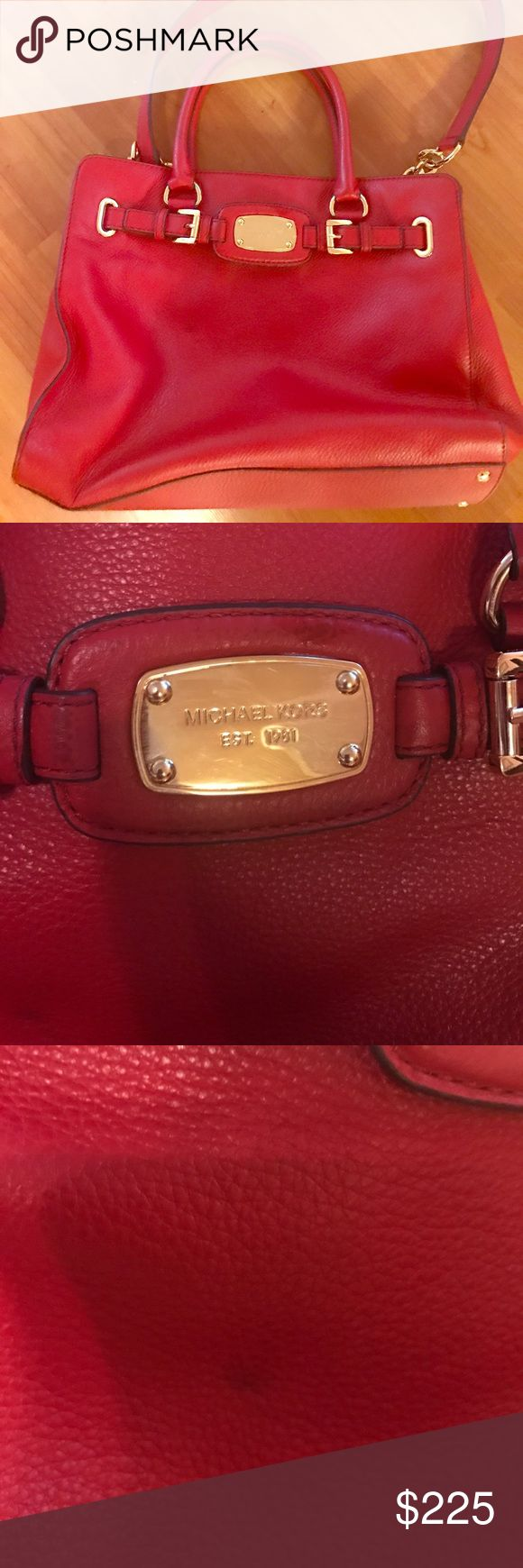 Michael Kors Red Handbag Gorgeous red Michael Kors Handbag. Has lots of compartments for makeup bag, wallet and phone with slight wear to bag as shown in pictures. Can be worn with handles or the long strap. No tradrs Michael Kors Bags