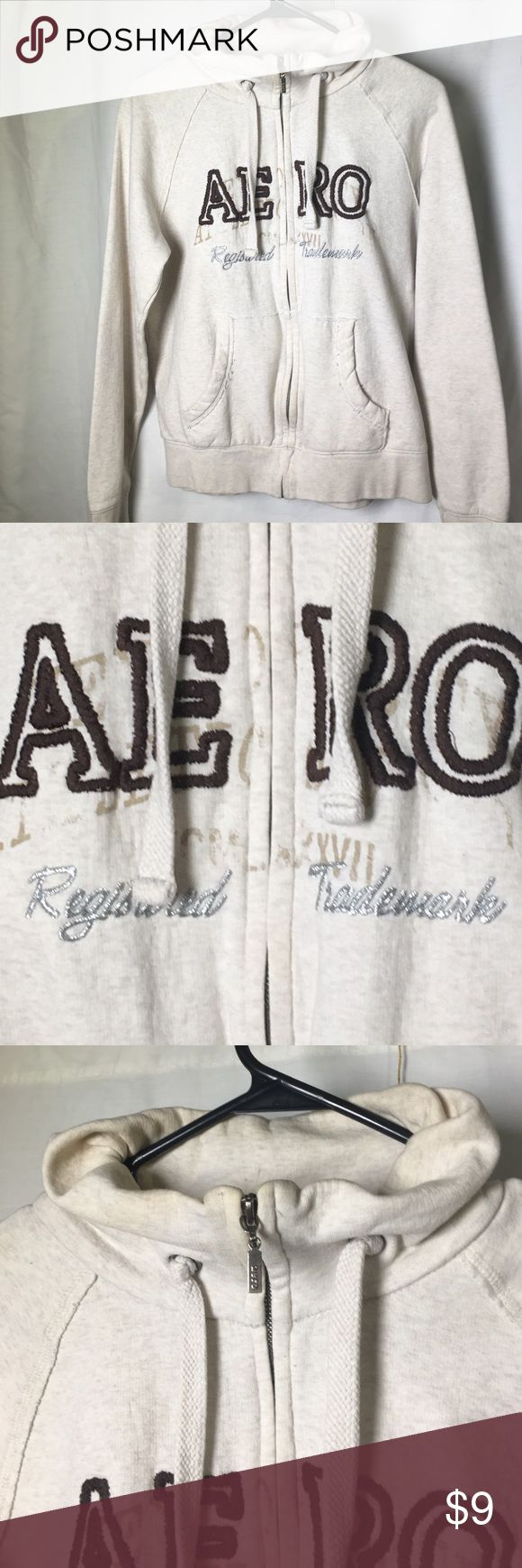 Aeropostale light beige zip up collared jacket Aeropostale zip up jacket. Light beige. Some of lettering wearing off but I think it's supposed to be like that, the style. Size large Aeropostale Jackets & Coats