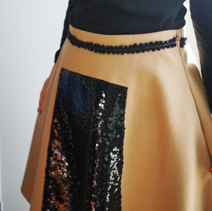 A personal favorite from my Etsy shop https://www.etsy.com/listing/253843293/wool-sequin-flared-skirt-glam-sequin