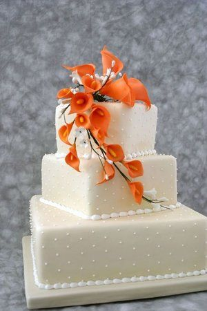 I really like the square layers love the Orange could go for summer spring or fall wedding