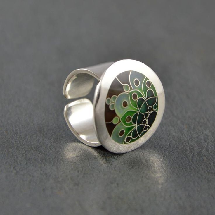"""Silver ring decorated with green shades ornament made of Georgian enamel """"Minanakri"""" known as Cloisonne."""