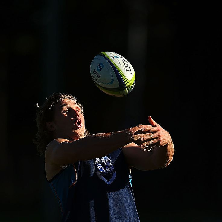 The Waratahs' Michael Hooper catches a ball during training