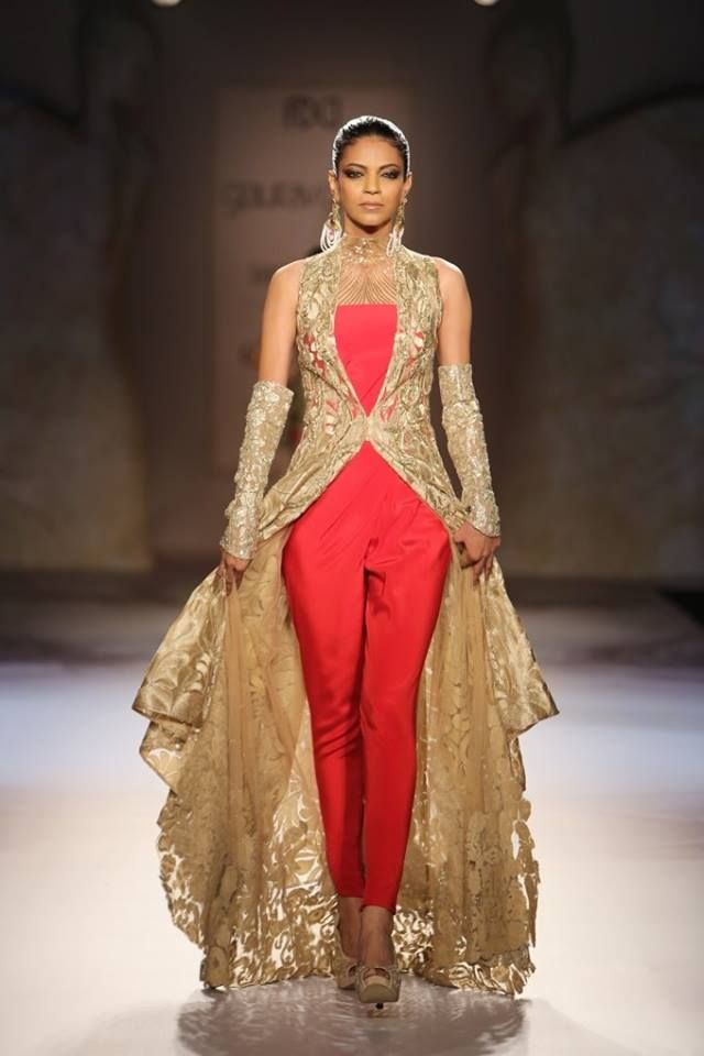 @gg_studio at India #Couture Week 2014 - red pant 'suit' w/ gold long #desi jacket http://www.gauravguptastudio.com/