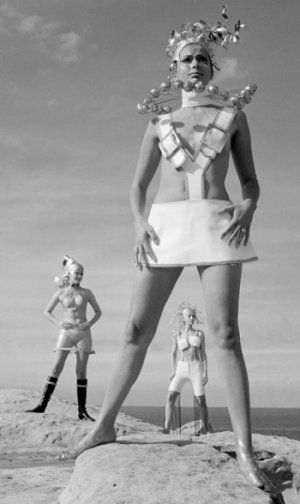 With the Space Race at the forefront of pop culture of the era, designers drew influence from the event, creating metallic astrological versions of futuristic costume.