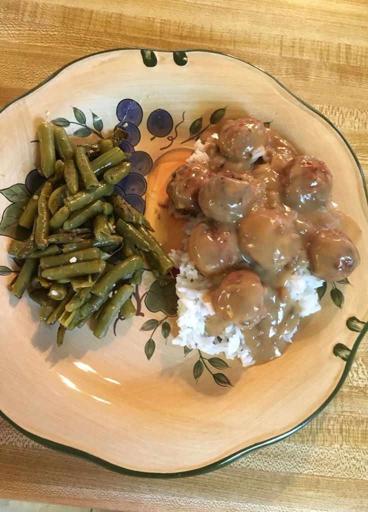 Crockpot meatballs with gravy 1 package of frozen meatballs 2 cans of cream of mushroom soup 1 packet of brown gravy 1 can beef broth Combine ingredients and place in crockpot. Cook on low 6-8hrs. Serve over rice or egg noodles #fbdinnerclub