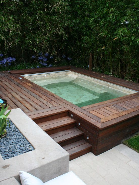 custom hot tub lined with handset tile, a custom electric pool cover and a custom deck surround