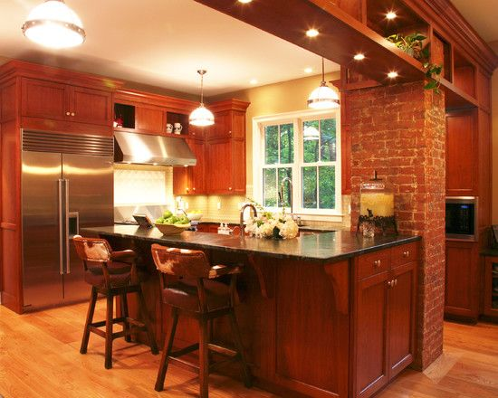 Warm And Cozy Kitchen Renovation That Incorporated The Existing Brick Chimney