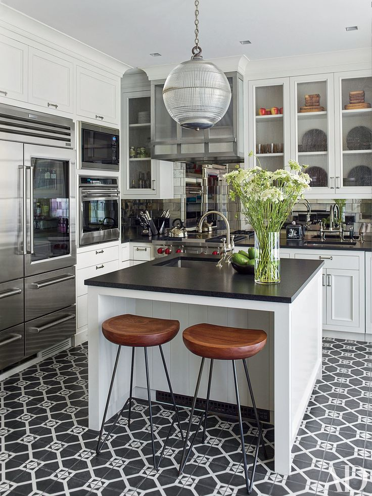 If you're looking to make a statement with your kitchen renovation, black countertops can be a perfect solution, whatever your personal style. Dark stone or Corian counters look sleek and modern paired with crisp white cabinets. Or, in a more traditional space, black granite or marble surfaces can add gravitas to rustic wood shelves or a colorful tile backsplash. A dark counter—whether glossy or matte—will make your whites look whiter and your tableware pop. Take a spin through these 20…