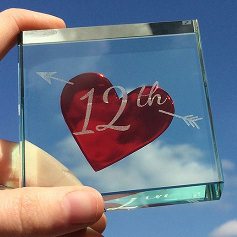 Over 12 years ago cupid's arrow pierced your heart and nothing has been the same since. No matter if you've been together 2 years or 24, this gift can be customised to reflect that number. #Gift #Love #Personalised #Anniversary #Token #Glass #Spaceform #Heart #London