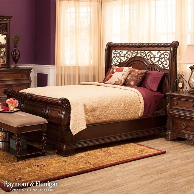 To unlock Vienna's full traditional potential, try supporting it with bold, eggplant-colored walls. Sheer curtains serve as a soft backdrop to showcase the refined features of this bedroom set. Tie your room together with the intricate design of a Persian style area rug.