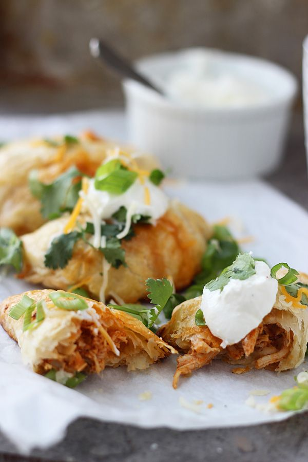 Chicken Enchilada Empanadas :: puff pastry, chicken, enchilada sauce, mexican cheese blend, cilantro, green onions & sour cream
