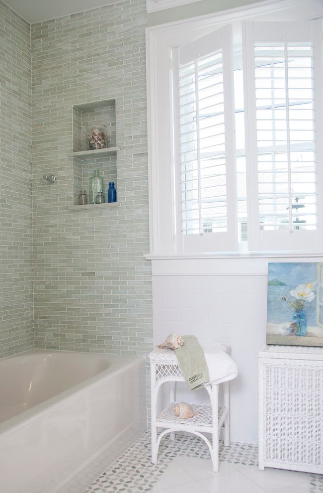 Elegant wicker hamper in Bathroom Beach Style with Bathroom Wall Tiles next to Plantation Shutters alongside Tiles Around Tub and Brick Stone Combination