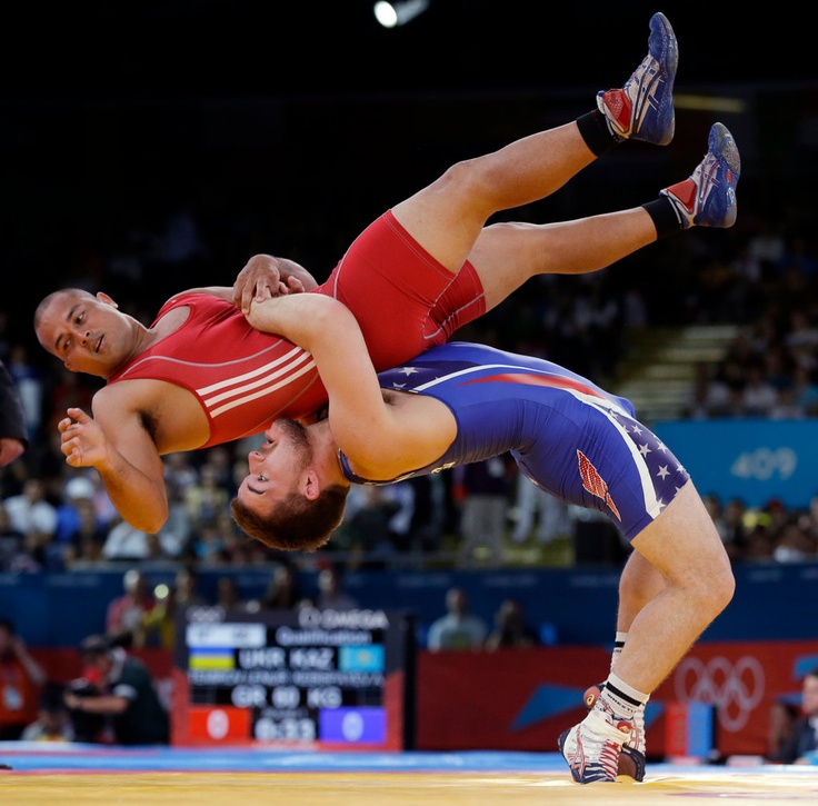 Keitani Graham of Micronesia competes against Charles Edward Betts of the United States, right, during the 84-kg Greco-Roman wrestling competition at the 2012 Summer Olympics, Monday, Aug. 6, 2012, in London. AP Photo, Paul Sancya.