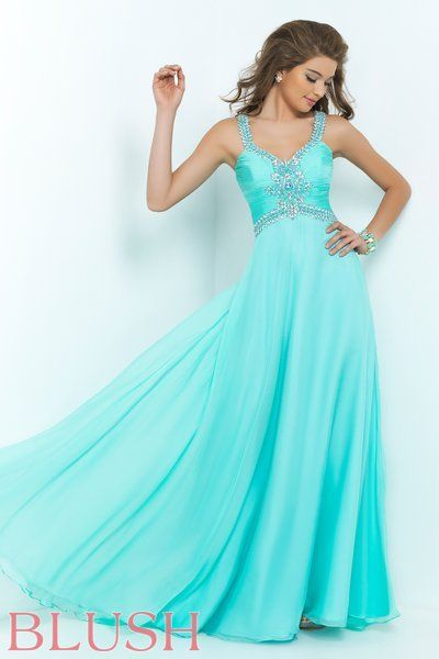 Talk about sweet and sassy! The rouged chiffon bodice and straps glitter with AB stones and clear crystals while the cut out back adds just enough drama to this phenomenal style. Dominate the dance floor in this full circle floor length chiffon skirt. Side zipper closure. Available in Aquamarine.