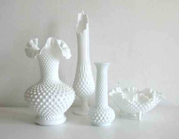 White Hobnail Milk Glass Collection.  Hobnail glassware gets its name from the studs, or round projections, on the surface of the glass. These studs were thought to resemble the impressions made by hobnails, a type of large-headed nail used in bootmaking.  Fenton Art Glass introduced Hobnail Glass in translucent colors in 1939 & Milk Glass Hobnail in 1950