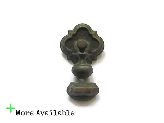 This listing is for 1 vintage drawer pull and the single screw for installation -Great worn brass colored patina -Solid, one pieces pull - no moving parts -Measurements: 3 tall, 1.75 wide, about 1.25 deep from drawer front when installed  Send me a message with any questions.  Location: