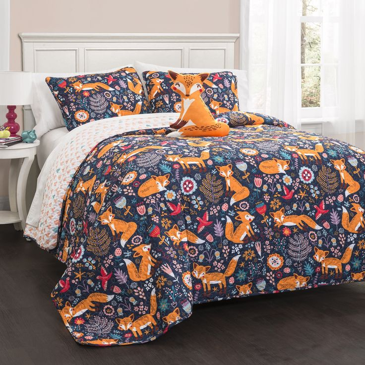 A friendly fox frolicks with frivolity over fields of flowers in this fantastically fun quilt set. Complete with a cute foxy companion that smiles cheerfully at you, this set is one that even adults w